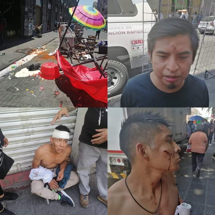 Cinco lesionados, saldo de riña entre ambulantes del Centro de Puebla